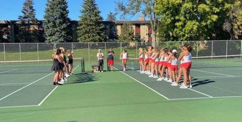 Girls tennis team introduces themselves to Cretin at Cretin-Derham Hall High School on Sept. 23. The team has been working hard at practice to prepare for conference matches like this.