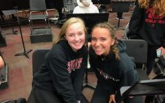 Seniors, Katie Sanderson, and Stella Cockson,  are band mentors in the Band Buddies program. They mentored elementary band students during the 2020-2021 school year, and hope to continue this year.