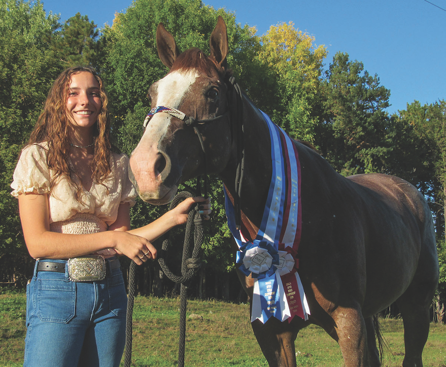 Junior+Alison+Bergmann%2C+with+the+horse+that+made+her+the+World+Champion.