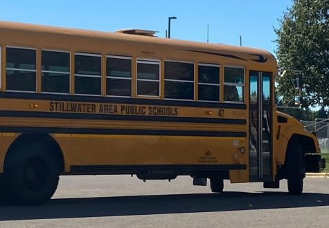 A district school bus picks up high school students to bring them home. The bus routes with drivers are making sure that students are transported to and from school safely.